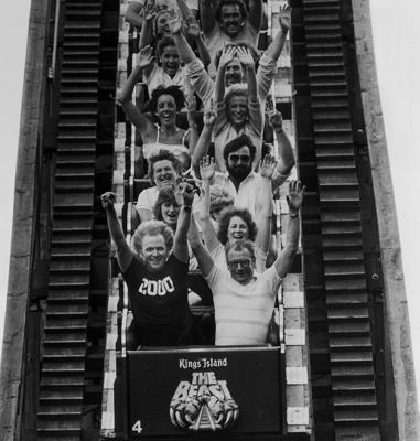 "Roller coaster enthusiast Carl Eichelman, in the front car on the left, plunges down the first hill of the roller coaster ""The Beast"" at Kings Island amusement park in Mason, Ohio."
