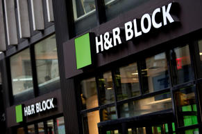 The H&R Block Inc. logo is displayed in front of the company's flagship office in New York.