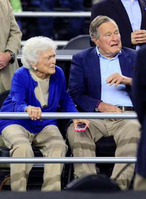 Former president George H.W. Bush and wife, Barbara Bush, in attendance March 29, 2015, before the finals of the south regional of the 2015 NCAA Tournament between the Duke Blue Devils and Gonzaga Bulldogs in Houston.