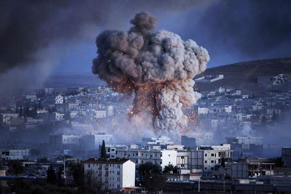 An explosion rocks Syrian city of Kobani on the Turkey-Syria border, October 20, 2014.