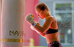 Mixed martial arts fighter Ronda Rousey works out at Glendale Fighting Club, Wednesday, July 15, 2015, in Glendale, Calif. Rousey, the UFC bantamweight champion, will return to the octagon against Brazil's unbeaten Bethe Correia at UFC 190 in Rio de Janeiro on Aug. 1.