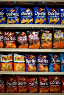 Various flavors of PepsiCo's Doritos brand snack chips sit on display in a supermarket in Princeton, Illinois, U.S., on Friday, Oct. 12, 2012.  Photographer: Daniel Acker/Bloomberg