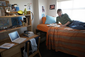 Young man in dorm room