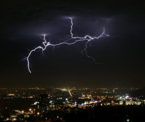 Lightning strikes across the night sky as a thunderstorm passes through Los Angeles in 2005.