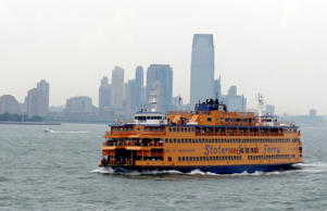 Commuters ride the Staten Island ferry in New York.