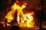 A house in the path of the Old Fire goes up in flames along Hook Creek Road in the San Bernardino Mountain community of Cedar Glen, 10/29/03.