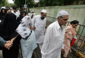 File: Brother of Tiger Memon, Suleiman Memon, third right, and members and relatives of the Memon family leave a special court trying cases of the 1993 Mumbai bombings that killed 257 people in Mumbai, India, Friday, July 27, 2007.