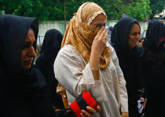 File: Wife  of Yakub Memon (2nd L) and other female relatives mourn the death sentence of Memon outside a special court in Mumbai July 27, 2007.