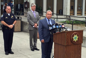 Santa Cruz District Attorney Jeffrey Rosell, right, holds a news where he announced that 15-year-old Adrian Jerry Gonzalez will be charged as an adult in the murder of 8-year-old Madyson Middleton in Santa Cruz, Calif., Wednesday, July 29, 2015. Police say Gonzalez lured Middleton from a courtyard where she had been riding her scooter over the weekend into his family's apartment where he attacked and killed her.