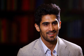 Vijender Singh gives a TV interview during a Press Conference at the Cinnamon Club on June 29, 2015 in London, England.