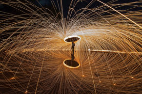 A brilliant explosion of light radiates from a spinning circle to create a spectacular firework-effect. The effect is created by spinning burning steel wool in a cage overhead - forcing sparks to fly away from the center. The sparks only last around 30 seconds but, thanks to a long exposure time of up to five seconds, their movement from the burning steel wool to burnout is captured perfectly in bright yellow lines.