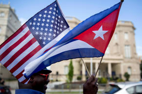 Eduardo Clark holds American and Cuban flags across the street from the Cuban embassy in Washington, D.C. Andrew Harrer/Bloomberg