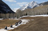 Disabled military veterans and instructors snowmobile along a tract of snow on March 29, 2012 at the T-Lazy 7 Ranch near Aspen, Colorado.