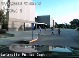 In this July 23, 2015, image taken from a dashboard camera provided by the Lafayette Police Department, people exit The Grand 16 theater in Lafayette, La. Authorities on Thursday, July 30, released several minutes of police radio transmissions and video from the day that John Russell Houser fired on a movie audience with a semi-automatic handgun, killing two and then himself.