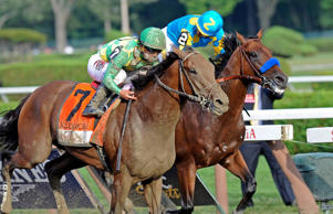 Keen Ice (7), with Javier Castellano, moves past Triple Crown winner American Pharoah, with Victor Espinoza, to win the Travers Stakes horse race at Saratoga Race Course on Aug. 29, 2015, in Saratoga Springs, N.Y.
