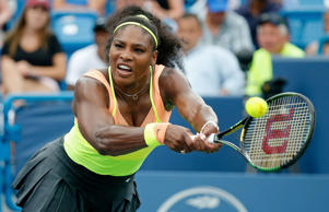 Serena Williams returns a shot to Simona Halep of Romania during her win in the womens finals of the Western & Southern Open at the Linder Family Tennis Center on August 23, 2015 in Cincinnati, Ohio.