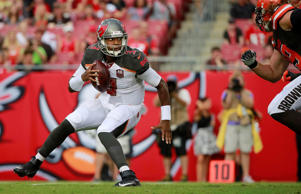 Tampa Bay Buccaneers quarterback Jameis Winston gets pressured against the Cleveland Browns during the first quarter Aug. 29 in Tampa Bay, Fla.
