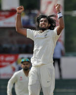 India's Ishant Sharma celebrates taking the wicket of Sri Lanka's Rangana Herath on the third day of their third test cricket match between them in Colombo, Sri Lanka, Sunday, Aug. 30, 2015. This was Sharma's fifth wicket of the innings.