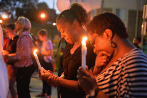 FILE - Mourning participants pause in a moment of prayer during a candlelight vigil held in honor of Jamyla Bolden in Ferguson, Missouri. Michael B. Thomas/Getty Images