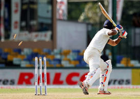 India's Lokesh Rahul is bowled out off a delivery by Sri Lanka's Nuwan Pradeep on the third day of their third test cricket match between them in Colombo, Sri Lanka, Sunday, Aug. 30, 2015.