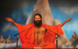 File: Indian yoga guru Baba Ramdev performs yoga at Sangam, the confluence of rivers Ganges, Yamuna and mythical Saraswati during the Maha Kumbh festival in Allahabad, Monday, Feb. 4, 2013.