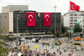 File photo of Turkish national flags hanging from the AKM Ataturk cultural center on Taksim Square