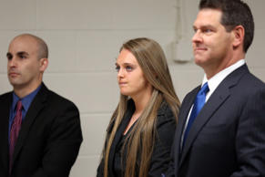 Michelle Carter stands in court with her attorneys Cory Madera, left, and Joseph Cataldo, Thursday, April 23, 2015, in New Bedford, Mass.