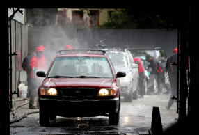 Cars enter the car wash at Divisadero Touchless Car Wash on March 20, 2015 in Sa...