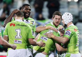 Raiders players celebrate during the round 25 NRL match between the Canberra Raiders and the Penrith Panthers at GIO Stadium on August 31, 2015 in Canberra, Australia.