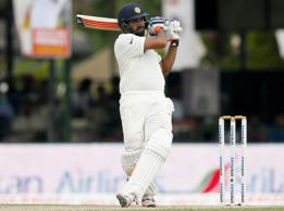 India's Rohit Sharma watches his shot during the first day of their second test cricket match against Sri Lanka in Colombo, August 20, 2015.