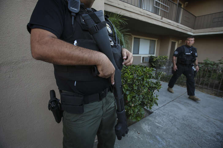 ICE Enforcement and Removal Operations unit raid to apprehend immigrants without any legal status and who may be deportable on Aug. 12, 2015 in Riverside, Calif.