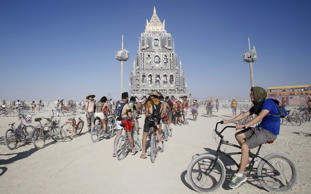 "Participants gather at the art installation ""Totem of Confessions"" during the Burning Man 2015 ""Carnival of Mirrors"" arts and music festival in the Black Rock Desert of Nevada, August 31, 2015. Approximately 70,000 people from all over the world are gathering at the sold-out festival to spend a week in the remote desert to experience art, music and the unique community that develops."