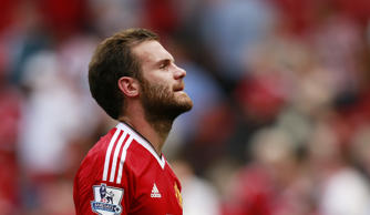 File: Manchester United's Juan Mata looks dejected after the match.