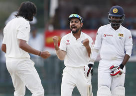 File: India's Ishant Sharma (L) celebrates with captain Virat Kohli (C) after taking the wicket of Sri Lanka's Upul Tharanga (R) during the fourth day of their third and final test cricket match in Colombo August 31, 2015.