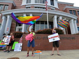 Quincy Swain, left, and Dallas Black protest Rowan County Clerk Kim Davis outsid...