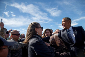 President Barack Obama greets visitors after arriving at Elmendorf Air Force Bas...