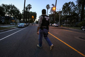 Jorge Field of ICE Enforcement and Removal Operations walks on his way to raid a...