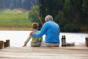 Man fishing with grandson. Monkey Business Images/Getty Images