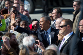 President Barack Obama greets a crowd after arriving at Elmendorf Air Force Base, Monday, Aug. 31, 2015, in Anchorage, Alaska.