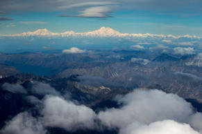 The newly-renamed Denali, top center, is seen from a window of Air Force One on approach to Anchorage, Alaska, Monday, Aug. 31, 2015. President Barack Obama changed the name of America's highest mountain from Mount McKinley at the opening of a historic three-day trip to Alaska aimed at showing solidarity with a state often overlooked by Washington.