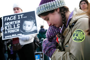 Pro-life activist Maribeth Kelly of Front Royal, Virginia, prays during the annual 'March for Life' event in front of U.S. Supreme Court January 22, 2010 in Washington, DC.