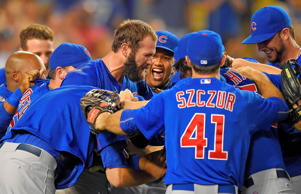 Chicago Cubs starting pitcher Jake Arrieta, with beard, celebrates with teammates after completing a no-hitter in a baseball game against the Los Angeles Dodgers, Sunday, Aug. 30, 2015, in Los Angeles. The Cubs won 2-0.