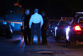 DeKalb County police officers work at the scene where an Atlanta-based officer w...