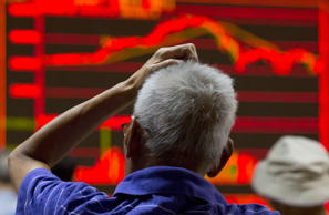 An electronic board displaying market movements at a brokerage in Beijing, Monday, Aug. 31, 2015.