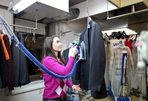 A worker presses a suit jacket at a dry cleaning shop in Davos, Switzerland.