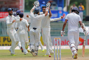 India's Ravichandran Ashwin, center, face to camera celebrates the wicket of Sri Lanka's Lahiru Thirimanne, right, with team mates on the final day of their third test cricket match in Colombo, Sri Lanka, Tuesday, Sept. 1, 2015.