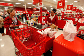 An employee checks out a customer at a Target store.