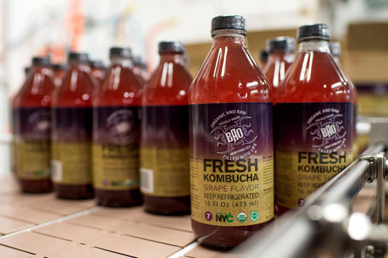 Bottles of kombucha are labeled at BAO Food and Drink, a manufacturer of organic fermented foods, which is located in the Organic Food Incubator in Long Island City, in the Queens borough of New York