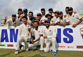 File: Indian cricketers pose with the trophy after they won the test cricket series against Sri Lanka in Colombo, Sri Lanka, Tuesday, Sept. 1, 2015. India won the third cricket test match by 117 runs and the series by 2-1.