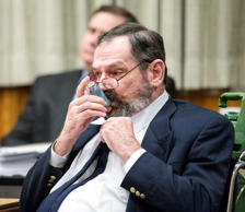 Frazier Glenn Miller Jr. uses his inhaler during the penalty phase of his murder trial, Tuesday, Sept. 1, 2015, at the Johnson County Courthouse in Olathe, Kan. Jurors, who convicted the white supremacist on Monday of killing three people at Jewish sites in suburban Kansas City in August 2014, began hearing more evidence Tuesday before deciding whether to recommend a death sentence.